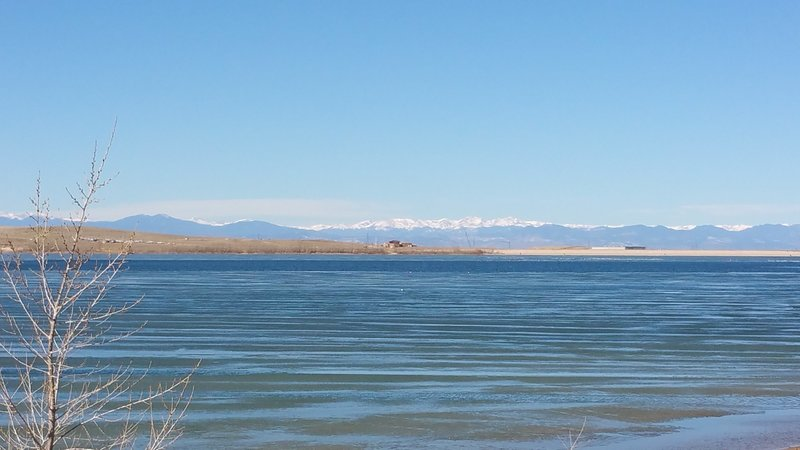 Looking across Aurora Reservoir toward the snow-capped summits of the James Peaks Wilderness.
