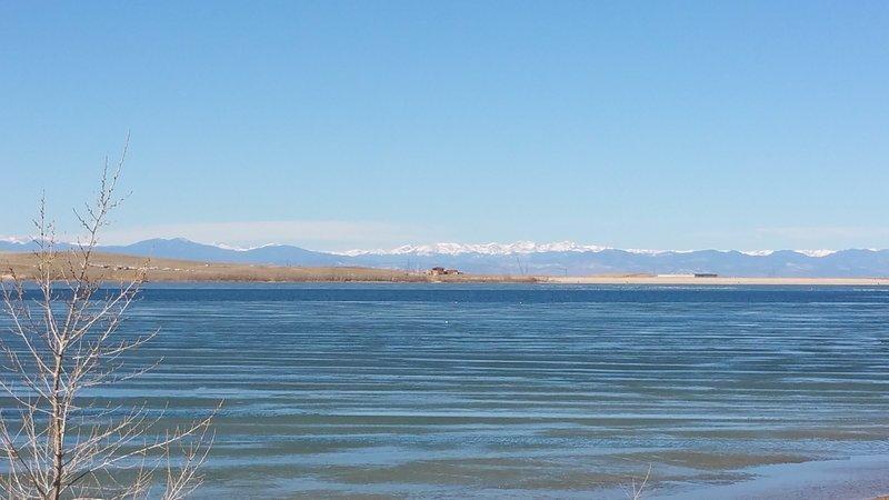 Looking across Aurora Reservoir toward the snow-capped summits of the James Peaks Wilderness.