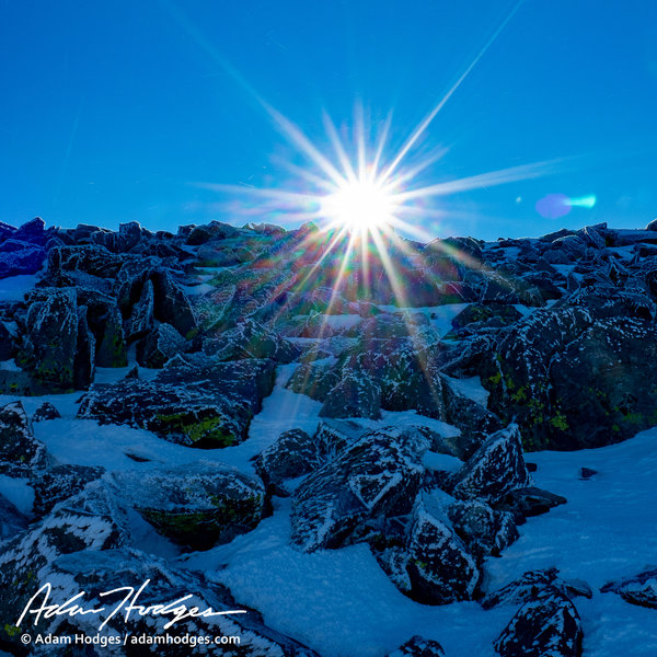 Just below the summit on a frosty October morning, the sun pokes over the top to greet me.