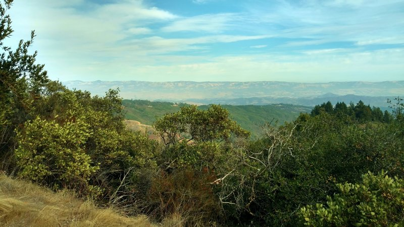 Beyond the Santa Cruz Mountains and Santa Clara Valley, is the Diablo Range in the far distance when looking east from high on Knibbs Knob Trail.