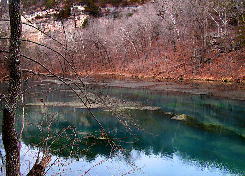 """On the Ha Ha Tonka Spring Trail, winter time, looking northwest, across the spring pool at cliffs below the """"castle."""" About:  37.973956, -92.768286"""