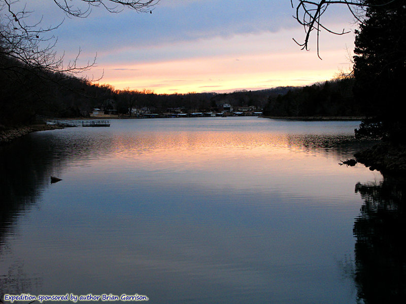 Winter sunset on a calm day, looking across Lake of the Ozarks from the bridge connecting Ha Ha Tonka's Spring Trail and Island Trail.  About:  37.974176, -92.771760