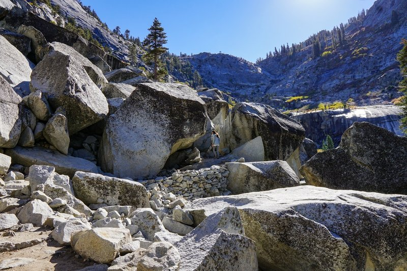 The trail winds through a large rockfall area on the way up the valley.