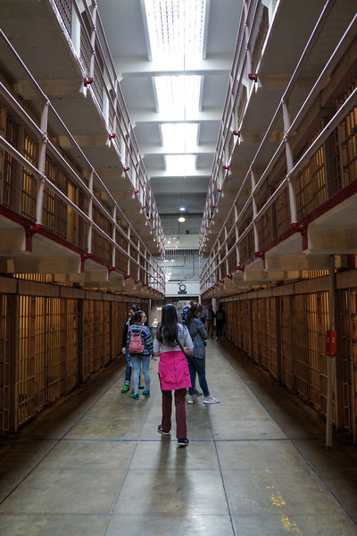 """Taking a stroll down """"Broadway"""" in the cell house of Alcatraz Prison."""