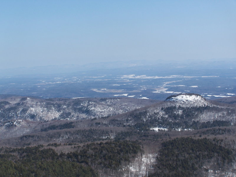 Sugar Loaf and Drowned Lands at Black Mountain. Sugarloaf is that little peak in the foreground. Drowned Lands, the lower portion of Lake Champlain can be seen in the background.
