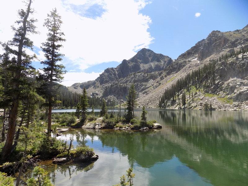Andrews Peak reflects in Lake Nanita.