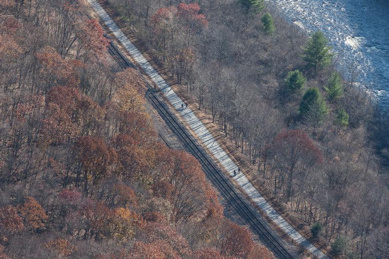 Bikers on the trail, rail tracks and Lehigh River