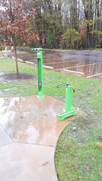 Bike repair stand and air pump in the main parking lot of Forest Ridge Park