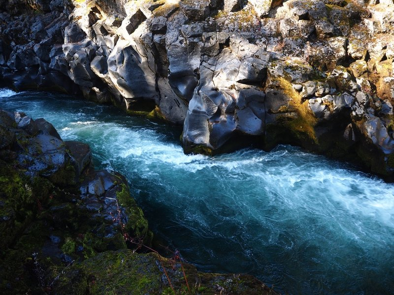 The river has polished the incredibly hard basalt to a smooth finish