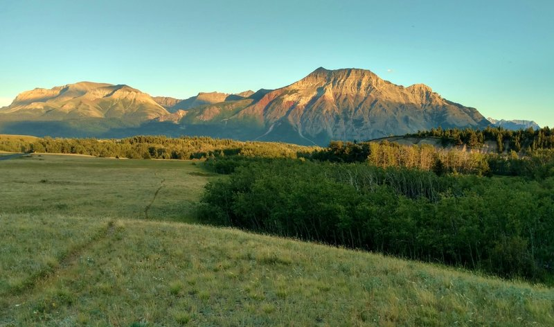 Vimy Peak in the setting sun, looking southeast along Red Rock Parkway.