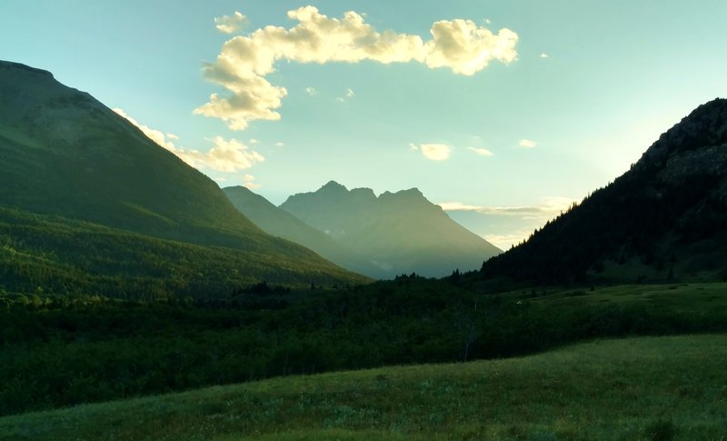 The sun sets behind the mountains to the west, as seen from the prairie along Horseshoe Basin Trail.