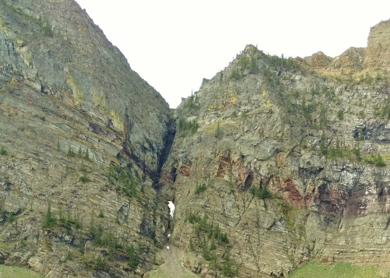 Avion Ridge Route is at the top of the cliffs behind Goat Lake.