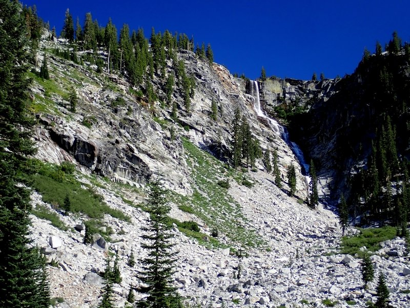 The scramble trail to Grizzly Lake climbs the broken slopes to the left.