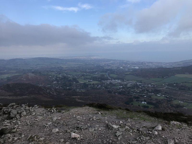 Hazy view of Dublin from peak