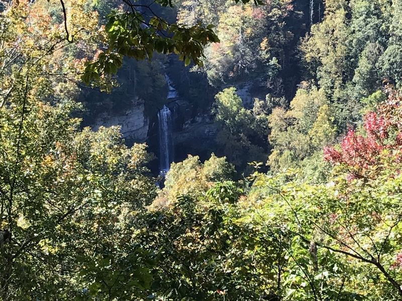 A view of Raven Cliff Falls from the over look which has a little roof shelter with benches to rest. This 400 foot fall is named for the 150 species of ravens breeding in the area and surrounding cliffs.