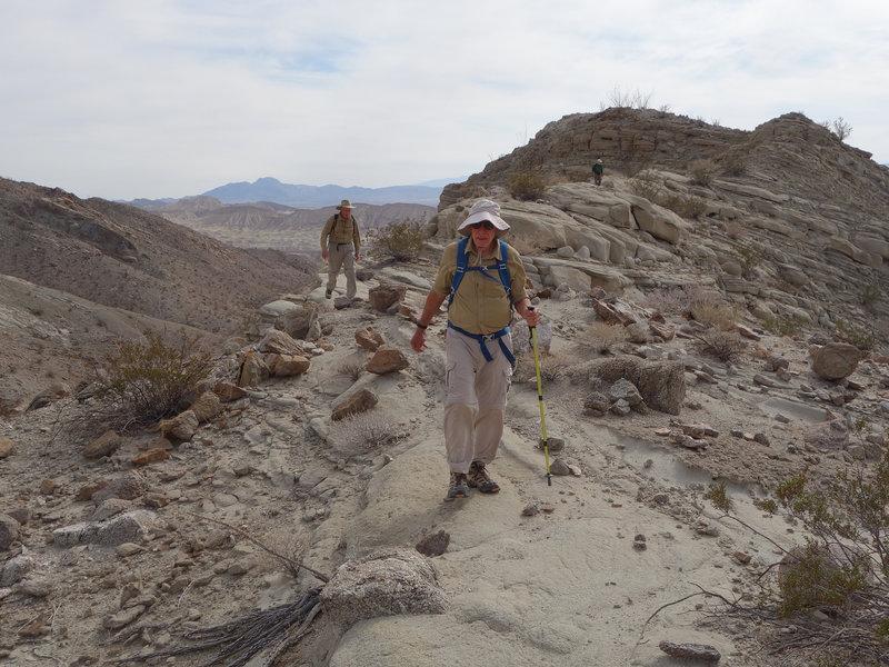 Hikers descending a spot elevation on the Split Mountain Loop