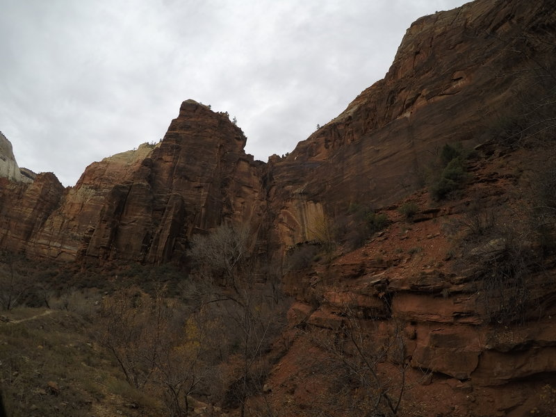 The rock wall that lays to the north of the trail.