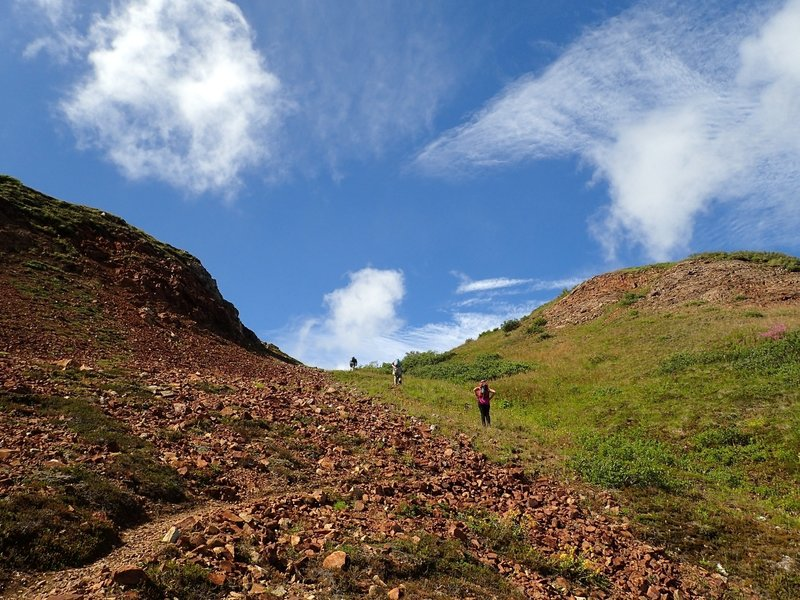 Climbing up through the notch to the alpine plateau