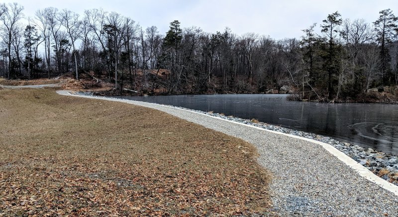 The Lake Hopatcong Trail turns into a footpath at the west end of Bear Pond.