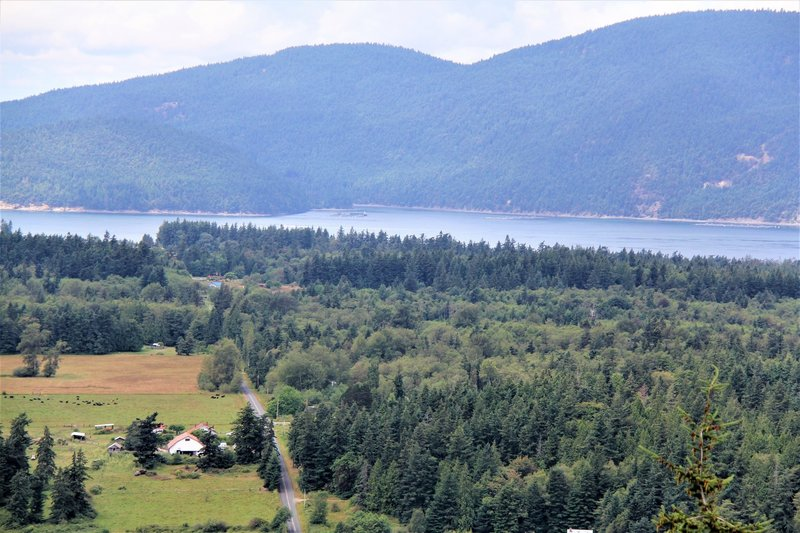 Edens Road valley with Cypress Island and Atlantic salmon pens in background
