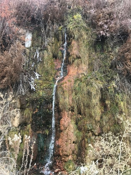 Skinny waterfall with interesting mineral deposits on the rocks.