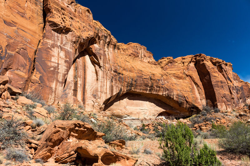 An arch in the canyon wall of Little Death Hollow