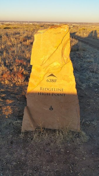 This stone marks the highest point on the ridgeline traversed by the East/West Regional Trail.