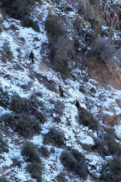 Hikers in the Siphon Draw ice chute.