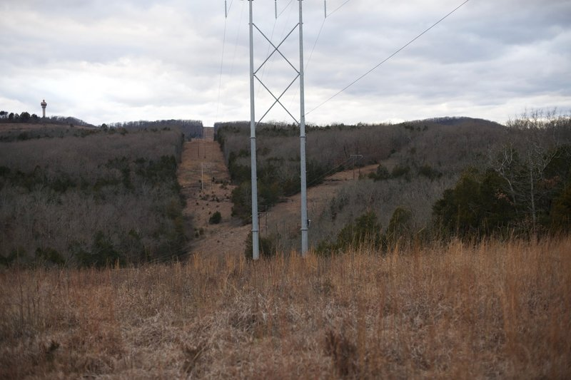 There are 3 areas where a power line crosses the trail.   From this view, you can see where the power lines split.  It provides an opening to see the surrounding hills and a break from walking through the woods.