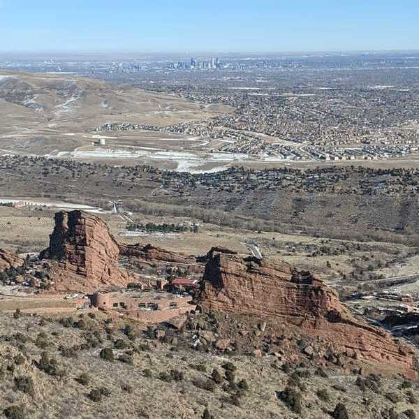 Red Rocks Amphitheatre and Denver in background.