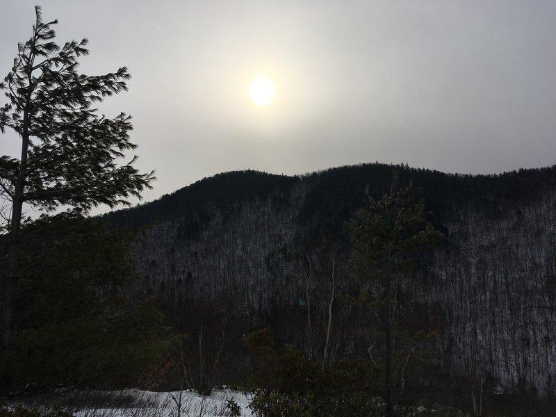 Hazy sun over the mountains.