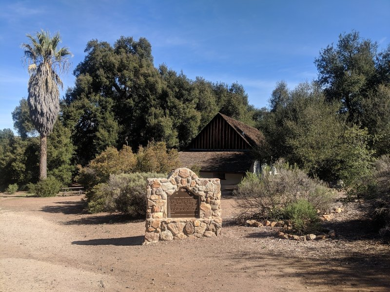 The entrance to the Moreno adobe from the trailhead. One of the many picnic tables can be seen in the background.