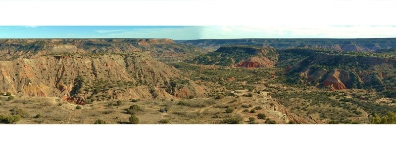 Palo Duro Canyon from the canyon rim viewpoint. 90 degree panorama. Left/east to right/south - ridge to Goodnight Peak with Prairie Dog Fork Red River behind it, Timber Creek in the foreground, and Timber Mesa on the far side of Timber Creek.