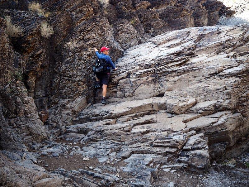 Climbing the last waterfall just below the petroglyphs