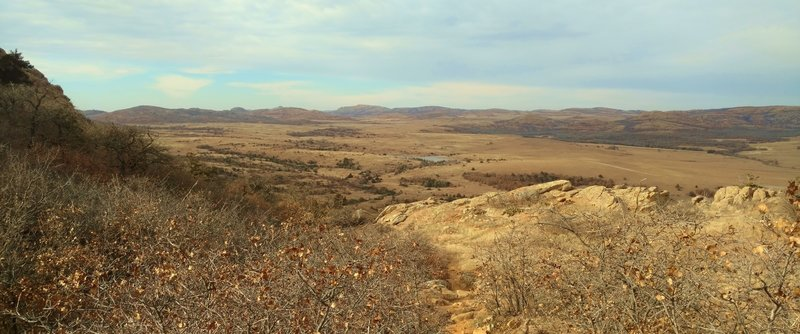 With an Elk Mountain shoulder to the left, Elk Mountain Trail heads northwest with views of Caddo Lake, the prairie, and Wichita Mountains.