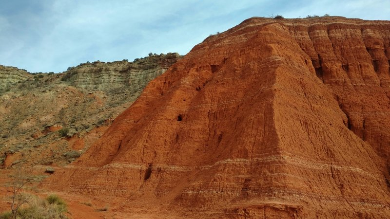 The various colors of the canyon wall layers up close, at the base of Fortress Cliffs on Comanche Trail North.