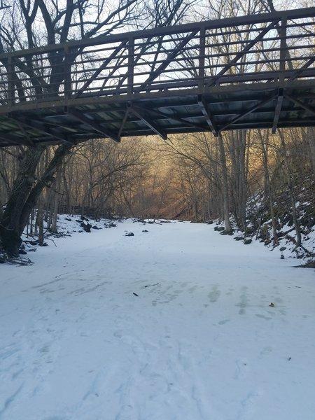 Walking Under a Bridge on Frozen Seven Mile Creek.