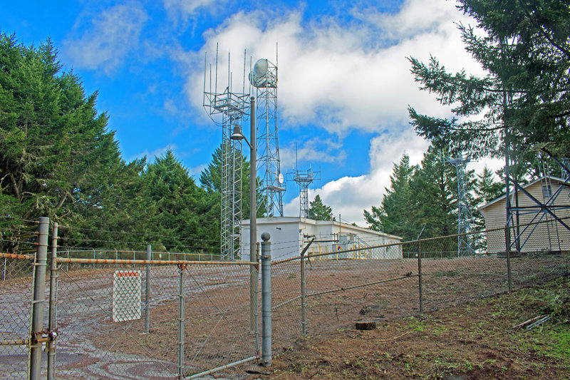 Air Traffic Control Station atop Scarper Peak. All views nearby are obstructed by trees and brush, including a lot of huge, old-growth, moss-covered Douglas Furs
