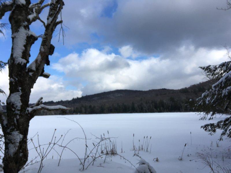 Frozen Lake under Cloudy Skies.