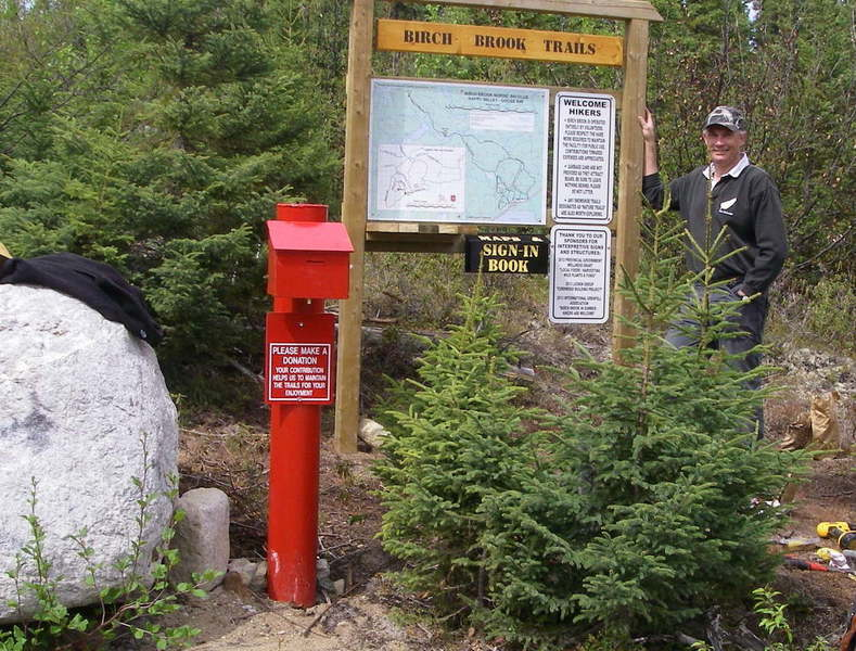 Trailhead for summer hiking with red collection box