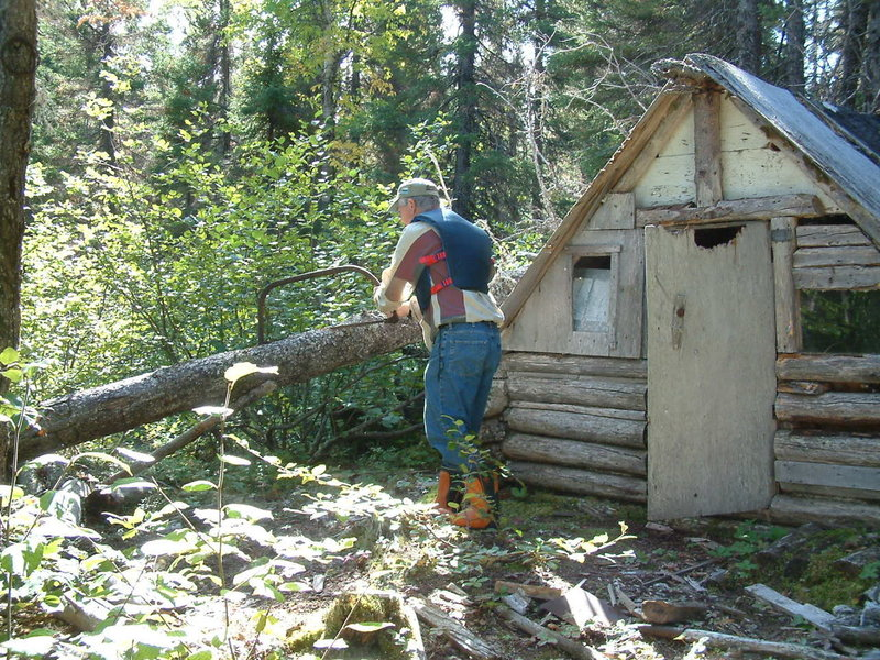 Sam repairing an old tilt by Tilt Pond on the back country trail beginning at Colin's Hut