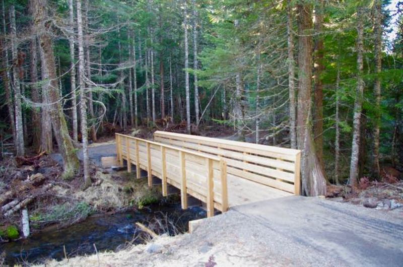 The first 1/4 mile of Mirror Lake Trail to the new bridge over Camp Creek is paved and barrier free.  A total of ten new bridges were flown in by helicopter on the relocated trail.  Photo by Knud Martin, Federal Lands Highway Division