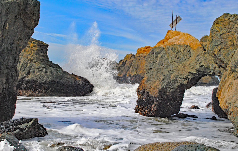 Colorful rock formations and waves and Mussel Rock Park