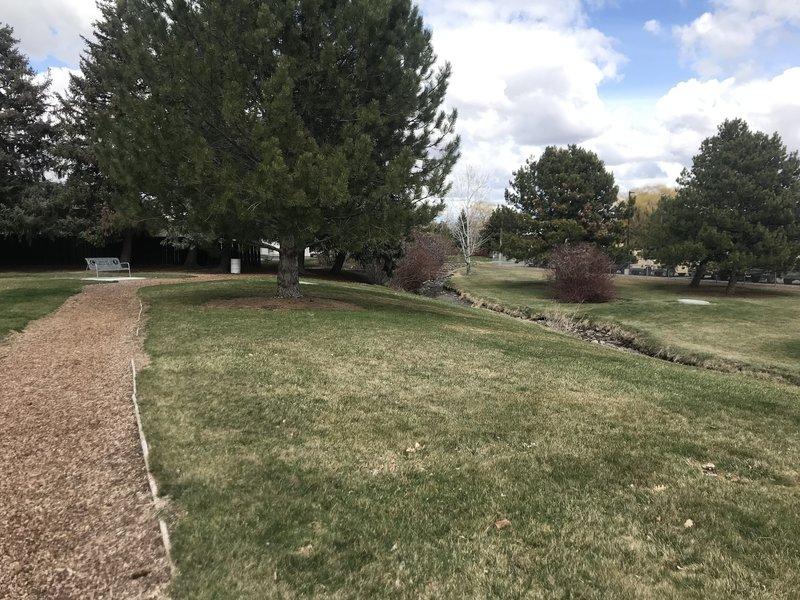 The soft mulch trail runs alongside a canal and through a disc golf course as well.