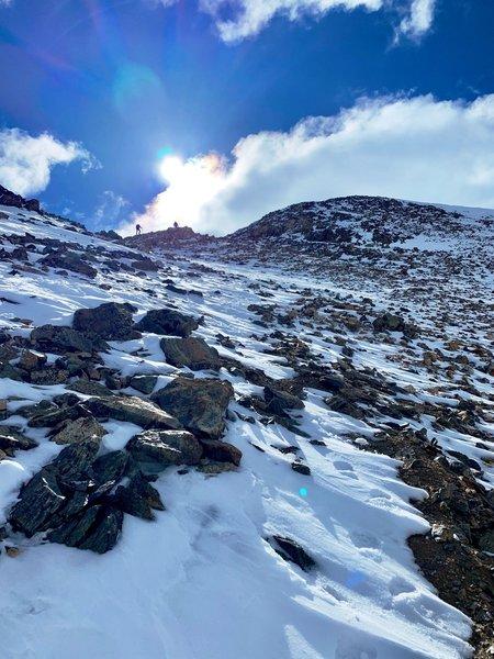 Loose rock and slushy snow.