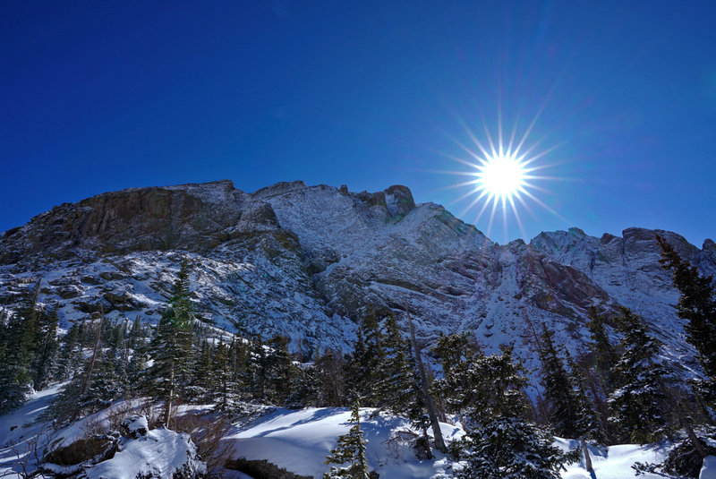 Wintertime at Willow Lake. This cliff overlooks the lake and the trail up its backbone leads to Challenger Point.