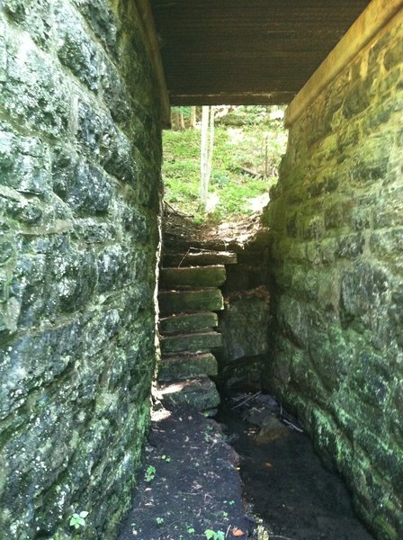 Near mile 18 there is a hidden support bridge. Here's a stone stairwell and corridor that runs beneath the trail.