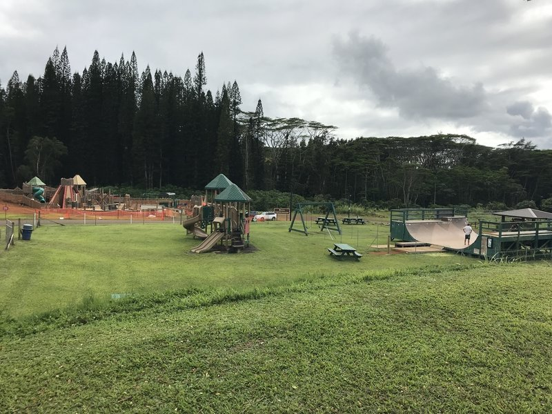 Playground and skatepark area at Anaina Hou Community Park.  Trailhead behind the playground.