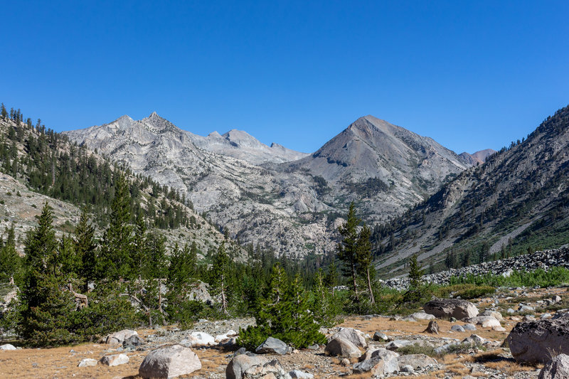 Looking back down the valley on the John Muir Trail with Pyramid Peak, Window Peak, and Castle Domes in the far.