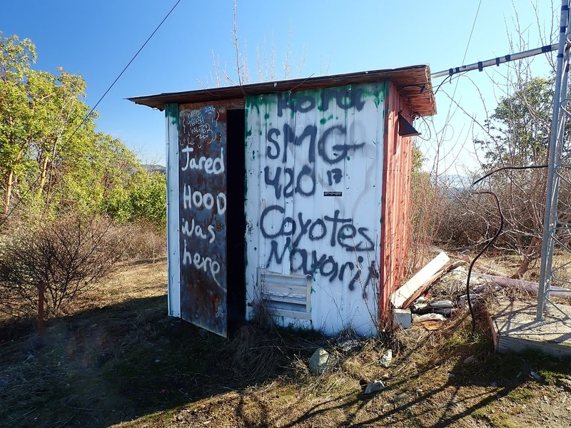 The colorful old comm shack atop Tin Pan Peak